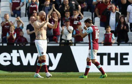 Britain Football Soccer - West Ham United v Swansea City - Premier League - London Stadium - 8/4/17 West Ham United's Mark Noble and James Collins celebrate after the match  Reuters / Eddie Keogh Livepic
