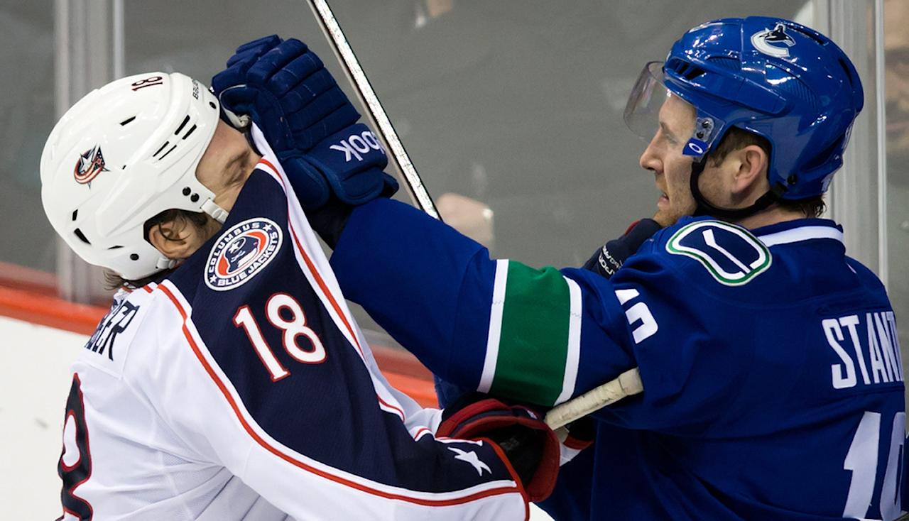 Vancouver Canucks' Ryan Stanton, right, roughs up Columbus Blue Jackets' R.J. Umberger during third period NHL hockey action in Vancouver, British Columbia, on Friday Nov. 22, 2013. (AP Photo/The Canadian Press, Darryl Dyck)