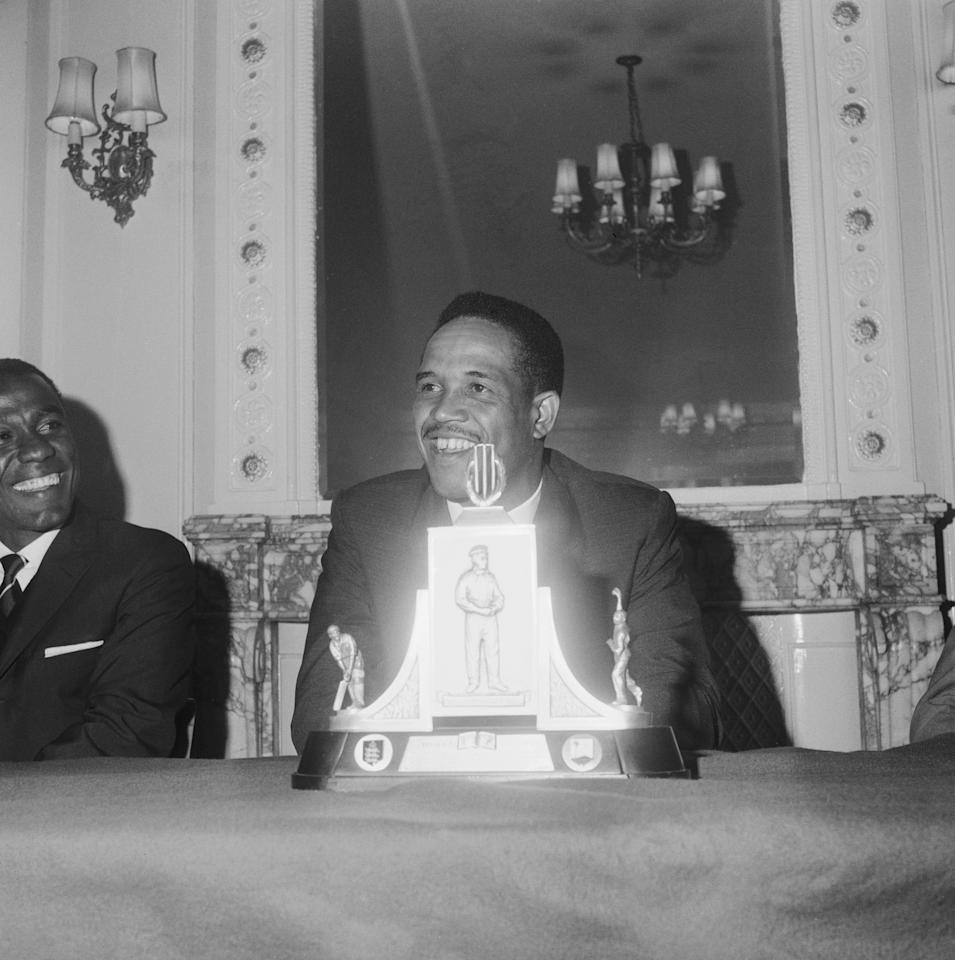 Garfield Sobers, also known as Gary, seated behind the Wisden Trophy during a press reception at the Waldorf Hotel, 1966. (Photo by Douglas Miller/Keystone/Hulton Archive/Getty Images)