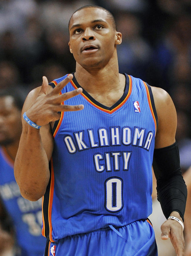 FILE - In this Dec. 21, 2013, file photo,, Oklahoma City Thunder guard Russell Westbrook celebrates a 3-point basket during the first half of an NBA basketball game against the San Antonio Spurs in San Antonio. Yes, the Thunder are rolling without him, but Westbrook, when healthy, is one of the most dynamic players in the NBA. He has been out since late December after having surgery on his right knee. (AP Photo/Darren Abate, File)