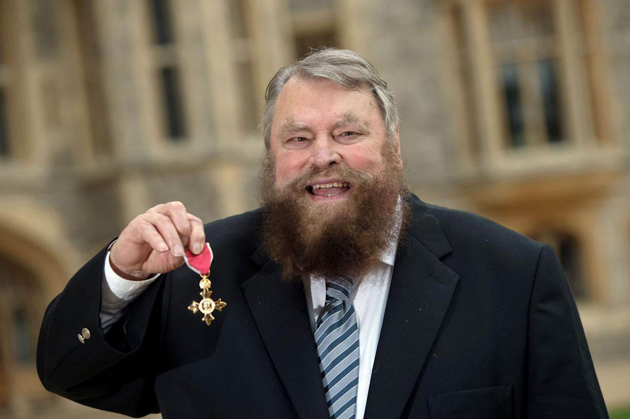 Actor Brian Blessed after he is made an Officer of the Order of the British Empire (OBE) by Queen Elizabeth II during an Investiture ceremony at Windsor Castle.