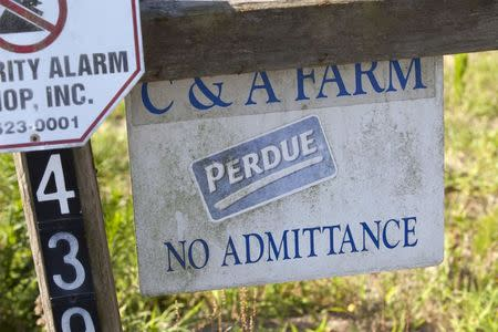 A faded sign shows the connection between Craig Watt's C&A Farms and Perdue in Fairmont, North Carolina June 10, 2014. REUTERS/Randall Hill