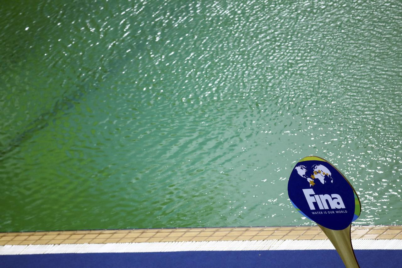 2016 Rio Olympics - Water Polo - Preliminary - Men's Preliminary Round - Group A Australia v Japan - Maria Lenk Aquatics Centre - Rio de Janeiro, Brazil - 10/08/2016. An International Swimming Federation (FINA) sign is seen in front of the Aquatics Centre pool where the water turned green. REUTERS/Kai Pfaffenbach FOR EDITORIAL USE ONLY. NOT FOR SALE FOR MARKETING OR ADVERTISING CAMPAIGNS.
