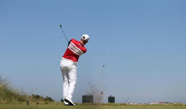 Henrik Stenson of Sweden plays a shot off the 13th tee during the first day of the British Open Golf championship at the Royal Liverpool golf club, Hoylake, England, Thursday July 17, 2014. (AP Photo/Peter Morrison)