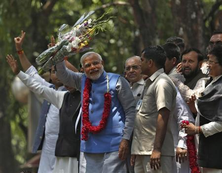 Hindu nationalist Narendra Modi, prime ministerial candidate for India's Bharatiya Janata Party, gestures to his supporters outside party's headquarters in New Delhi