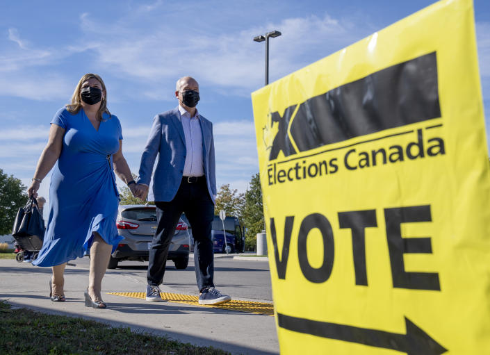 <p>Conservative Leader Erin O'Toole and his wife Rebecca arrive to vote in the Canadian federal election in Bowmanville, Ont., on Monday, September 20, 2021. THE CANADIAN PRESS/Frank Gunn</p>