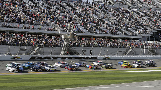 Ryan Newman (6) and Brad Keselowski, front left, lead the field to start the NASCAR Busch Clash auto race at Daytona International Speedway, Sunday, Feb. 9, 2020, in Daytona Beach, Fla. (AP Photo/Terry Renna)