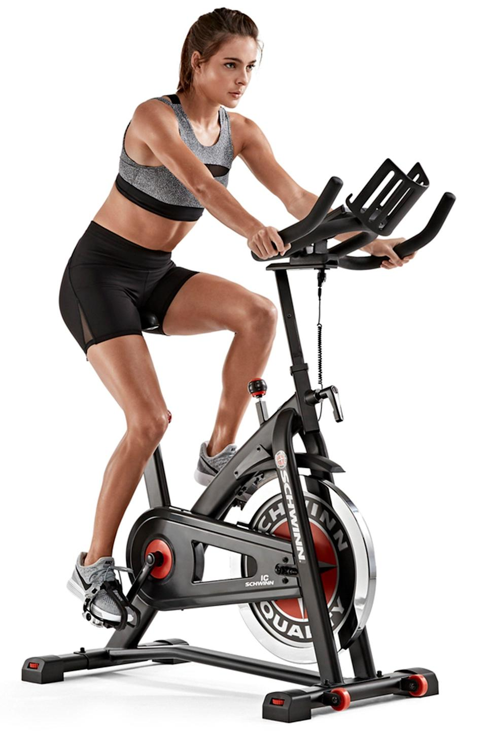 """<p><strong>Schwinn</strong></p><p>walmart.com</p><p><strong>$649.00</strong></p><p><a href=""""https://go.redirectingat.com?id=74968X1596630&url=https%3A%2F%2Fwww.walmart.com%2Fip%2F183731475%3Fselected%3Dtrue&sref=https%3A%2F%2Fwww.womenshealthmag.com%2Ffitness%2Fg37679339%2Fwalmart-indoor-exercise-bike-sale%2F"""" rel=""""nofollow noopener"""" target=""""_blank"""" data-ylk=""""slk:Shop Now"""" class=""""link rapid-noclick-resp"""">Shop Now</a></p><p>Bring your workout to the digital age with Schwinn's IC3 cycling bike. This simple, upright style is designed with a tablet holder, which allows you to easily follow workout programs through apps on your phone or iPad (or you can just scroll through TikTok—both work!).</p>"""