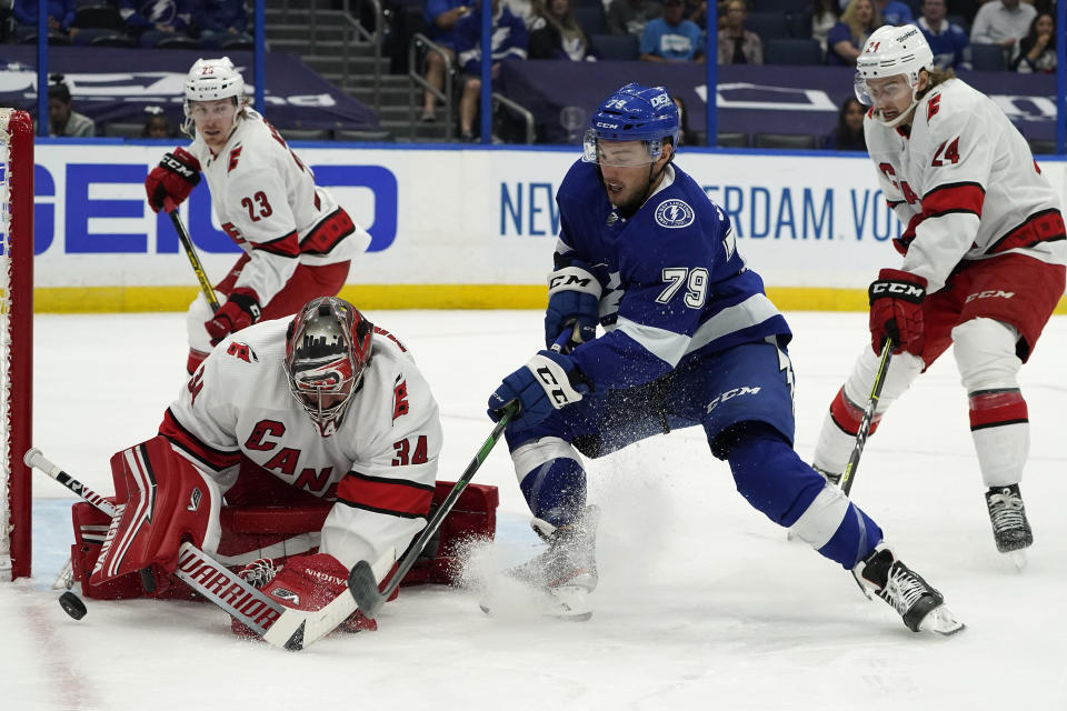 Carolina Hurricanes goaltender Petr Mrazek (34) stops a shot by Tampa Bay Lightning left wing Ross Colton (79) during the second period in Game 4 of an NHL hockey Stanley Cup second-round playoff series Saturday, June 5, 2021, in Tampa, Fla. (AP Photo/Chris O'Meara)
