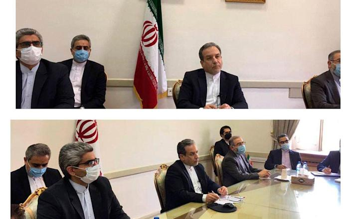 Iranian diplomats attending a virtual talk on nuclear deal with representatives of world powers, in Tehran, Iran - Iranian Foreign Ministry