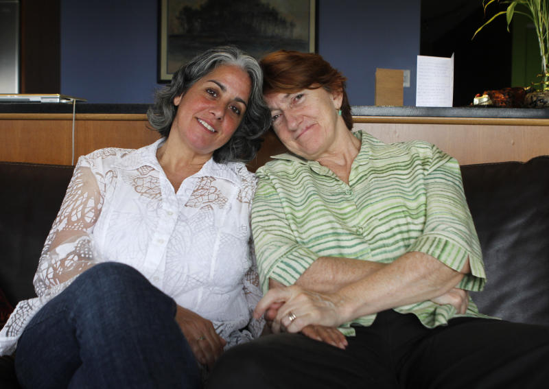 In this Friday July 20, 2012 photo, Carol Anastosio,left, and Mimi Brown pose in their New York home. They are celebrating their one-year anniversary after New York State legalized gay marriage last year.  (AP Photo/ Fay Abuelgasim)