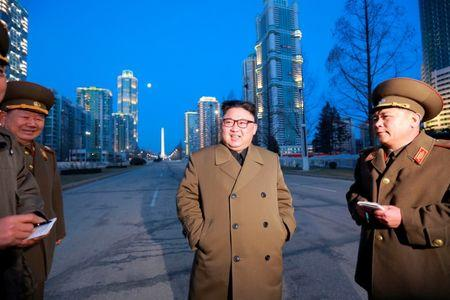 North Korean leader Kim Jong Un provides field guidance at the construction site of Ryomyong Street