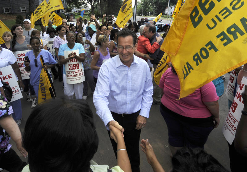 "Connecticut Gov. Dannel P. Malloy meets with striking nursing home workers at Newington Health Care Center in Newington, Conn., Wednesday, July 11, 2012. Workers at five HealthBridge-owned nursing homes around the state went on strike last week after the health care company declined to return to the bargaining table. Malloy said it's clear the company has taken ""unfair actions"" against employees, citing last week's federal complaint against the company issued by the National Labor Relations Board. (AP Photo/Jessica Hill)"