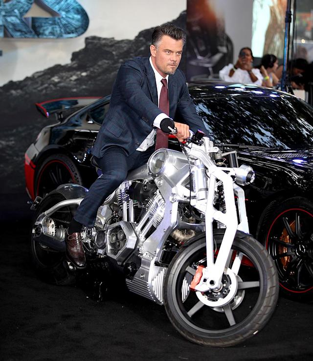 <p>The dashing star of <i>Transformers: The Last Knight</i> posed with some hot wheels at the movie's London premiere. See, this is his dangerous look… (Photo: Mike Marsland/Mike Marsland) </p>