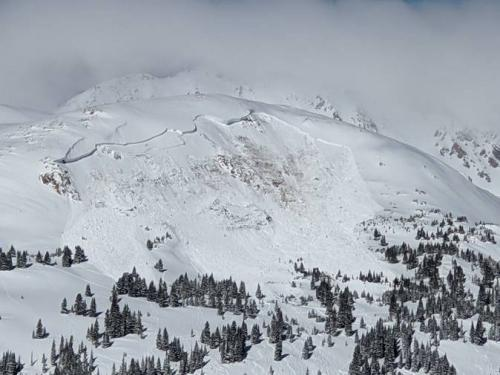 The aftermath of an avalanche that killed an unidentified snowboarder on 14 February, near the town of Winter Park in Colorado.