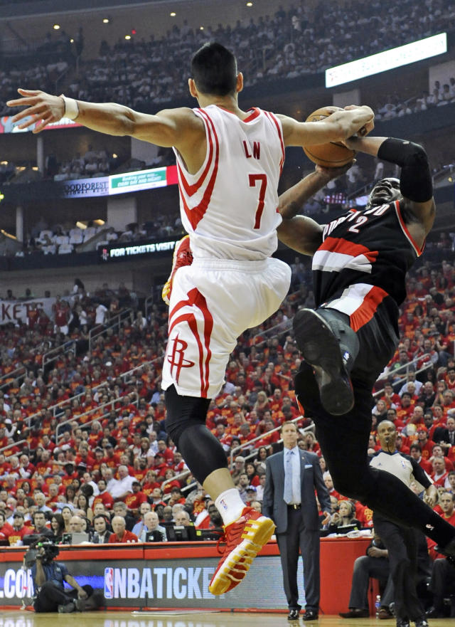 Portland Trail Blazers' Wesley Matthews (2) falls from Houston Rockets' Jeremy Lin (7) in the first half of Game 5 of an opening-round NBA basketball playoff series Wednesday, April 30, 2014, in Houston. (AP Photo/Pat Sullivan)