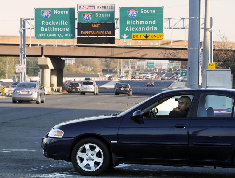 A driver waits to turn onto Route 7, near the Interstate 495, Capital Beltway, interchange at Tysons Corner in Fairfax County, Va., Friday, Nov. 9, 2012. The $2 billion, 14-mile, decade-in-the-making Express Lanes are set to open Nov. 17. The four Express Lanes, two northbound and two southbound, supplement the existing eight lanes on the Virginia side of the Beltway. (AP Photo/Cliff Owen)