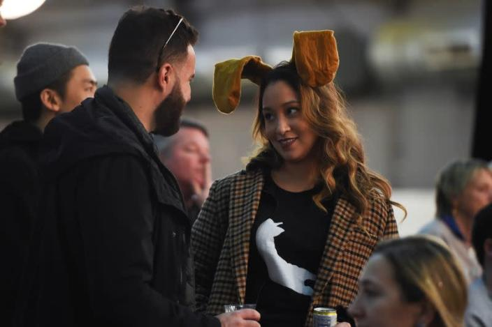 A woman wears dog ears during the Masters Agility Championship during the Westminster Kennel Club Dog Show in New York
