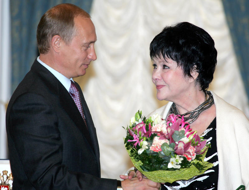In this June 15, 2004 file photo Russian President Vladimir Putin congratulates poet Bella Akhmadulina after awarding her with the State Award  in the field of Arts and Literature in the Kremlin in Moscow. The Moscow Writers Union says that Bella Akhmadulina, one of the most popular poets of the Soviet era, has died at age 73. In the 1960s Akhmadulina and other poets of her generation drew audiences of thousands striving for intellectual freedom in a brief thaw that followed Soviet dictator Josef Stalin's death.  (AP Photo / Alexander Nemenov, Pool)