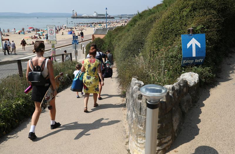 People make their way down towards Bournemouth beach in Dorset. (Photo by Andrew Matthews/PA Images via Getty Images)