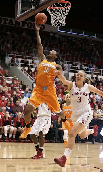 Tennessee forward Bashaara Graves (12) drives to the basket past Stanford forward Mikaela Ruef (3) during the first half of an NCAA women's college basketball game, Saturday, Dec. 21, 2013, in Stanford, Calif. (AP Photo/Tony Avelar)