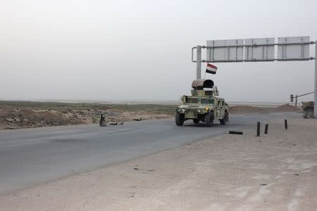 A convoy of Iraqi security forces drives on a road during a patrol in the Hamrin mountains in Diyala province July 25, 2014. Picture taken July 25, 2014. REUTERS/Stringer