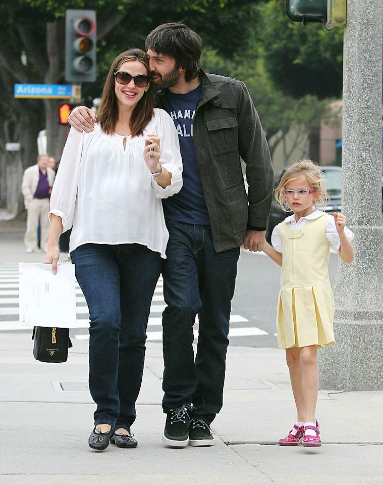 Proving again that they're America's happiest family, a bearded Ben Affleck got cozy with wife Jennifer Garner (who's pregnant with baby number three) as they took a trip with eldest daughter Violet to a post office and an ice cream shop in Santa Monica, California, on Wednesday. (11/30/2011)