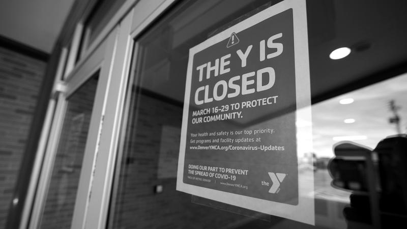 A sign hangs on the door to the Schlessmann YMCA as gyms have been forced to close in Colorado's efforts to fend off the spread of coronavirus on March 16, 2020, in Denver. (David Zalubowski/AP)