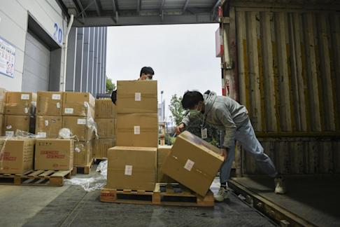 Workers in China load donated medical supplies bound for the United States. Photo: Handout