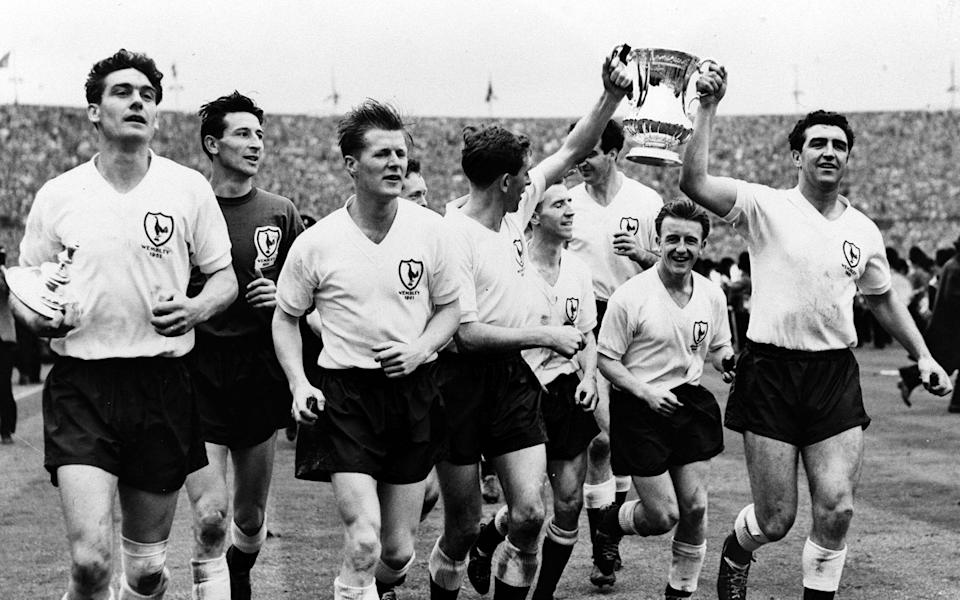 Tottenham players parade the FA Cup after completing their historic league and cup double, L-R: Ron Henry, Bill Brown, Peter Baker, Danny Blanchflower, Cliff Jones, Maurice Norman, Terry Dyson, and Bobby Smith - Popperfoto via Getty Images/Getty Images