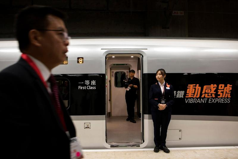 An attendant stands on duty near the high-tech new train service (AP)