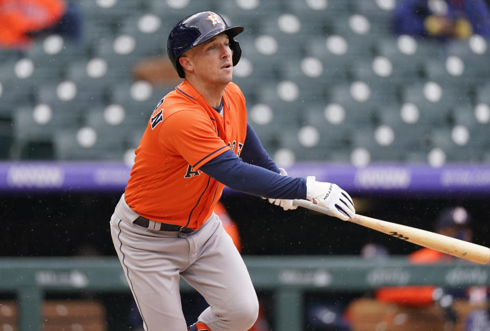 Houston Astros' Alex Bregman fouls off a pitch against the Colorado Rockies in the fourth inning of a baseball game Wednesday, April 21, 2021, in Denver. (AP Photo/David Zalubowski)