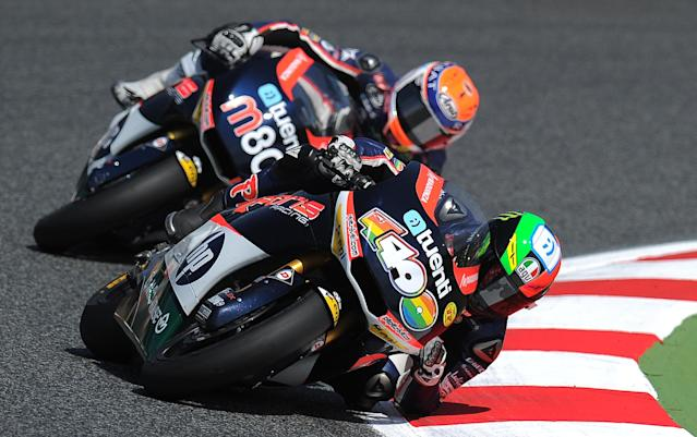 Pons 40 HP Tuenti's Spanish Pol Espargaro takes a curve at the Catalunya racetrack in Montmelo, near Barcelona, on June 2, 2012, during the Moto2 qualifying session of the Catalunya Moto GP Grand Prix. Espargaro took the second position.AFP PHOTO/LLUIS GENELLUIS GENE/AFP/GettyImages
