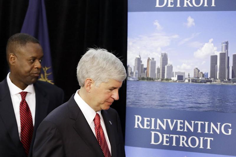 FILE - In this July 19, 2013 file photo, Michigan Gov. Rick Snyder, right, and state-appointed emergency manager Kevyn Orr leave a news conference in Detroit after addressing the city's bankruptcy. The decision to make Detroit the largest U.S. city to file for bankruptcy protection was tough to make, but it was the right one, Snyder said Sunday, July 21, 2013, as he and Orr made the television talk show rounds. (AP Photo/Carlos Osorio, File)