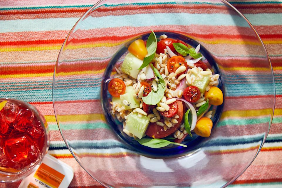 """When picnic ideas abound, this grain salad has a leg up because of semi-pearled grains that cook quickly and have a roughened-up texture that helps soak up the dressing. Also, browning the grains first deepens their flavor. <a href=""""https://www.epicurious.com/recipes/food/views/farro-spelt-grain-salad-with-tomatoes-and-cucumbers?mbid=synd_yahoo_rss"""" rel=""""nofollow noopener"""" target=""""_blank"""" data-ylk=""""slk:See recipe."""" class=""""link rapid-noclick-resp"""">See recipe.</a>"""