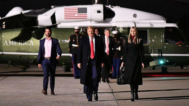 PHOTO: Donald Trump Jr., President Donald Trump and daughter Senior Advisor Ivanka Trump make their way to board Air Force One before departing from Dobbins Air Reserve Base in Marietta, Ga, Jan. 4, 2021. (Mandel Ngan/AFP via Getty Images, FILE)