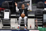 Washington Wizards guard Russell Westbrook sits on the sidelines before an NBA basketball game against the Chicago Bulls, Tuesday, Dec. 29, 2020, in Washington. (AP Photo/Nick Wass)