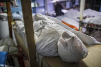 Bodies are wrapped in protective plastic in a holding facility during the coronavirus pandemic at Daniel J. Schaefer Funeral Home, April 2, 2020, in the Brooklyn borough of New York. (AP Photo/John Minchillo)