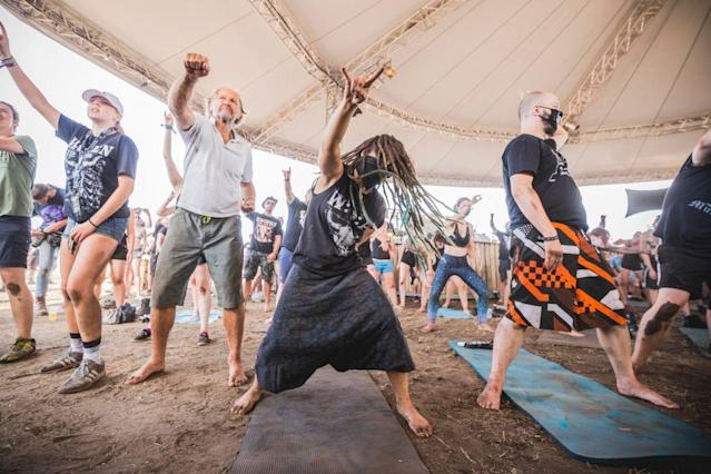 Visitors doing metal yoga during the Wacken Open Air festival in Germany (Picture: Getty)