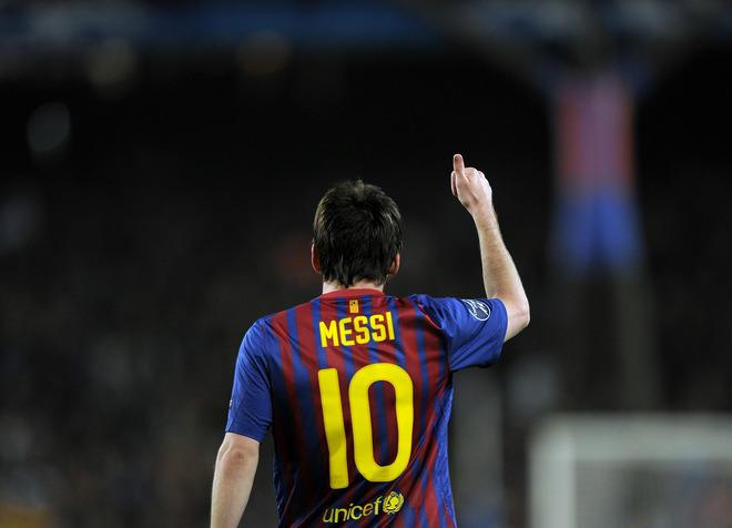 TOPSHOTS Barcelona's Argentinian forward Lionel Messi celebrates scoring his second penalty during the Champions League quarter-final second leg football match FC Barcelona vs AC Milan on April 3, 2012 at Camp Nou stadium in Barcelona. FC Barcelona defeated AC Milan 3-1 to reach the semi-finals.      AFP PHOTO / LLUIS GENE