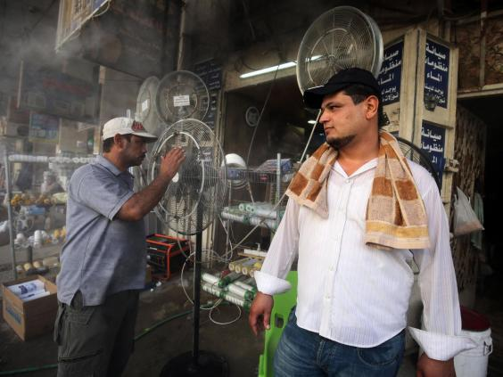 Fans are displayed at a shop selling cooling and ventilation products in Baghdad (AFP/Getty Images)