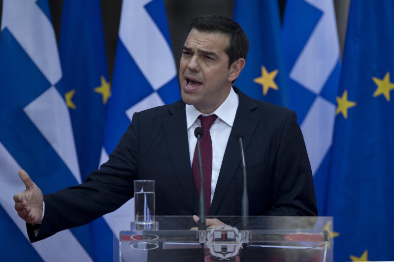 For once in a tie, Greek PM Tsipras hails new debt deal