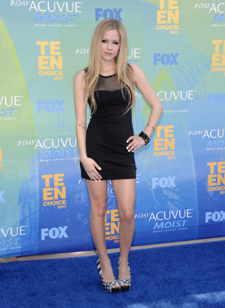 FILE - In this Aug. 7, 2011 file photo, Avril Lavigne arrives at the Teen Choice Awards in Universal City, Calif. A spokeswoman for Lavigne confirmed a Tues., Aug. 21, 2012 report from People.com that Lavigne and Nickelback frontman Chad Kroeger were engaged earlier this month after a six-month courtship. (AP Photo/Dan Steinberg, file)