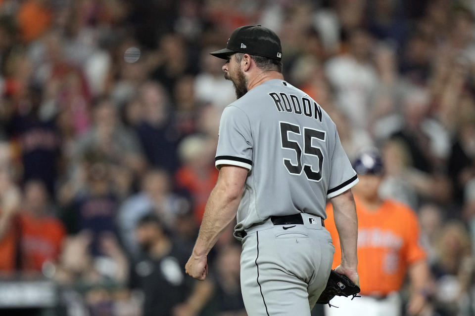Chicago White Sox starting pitcher Carlos Rodon (55) yells after striking out Houston Astros' Jose Altuve with the bases loaded to end the fifth inning of a baseball game Friday, June 18, 2021, in Houston. (AP Photo/David J. Phillip)
