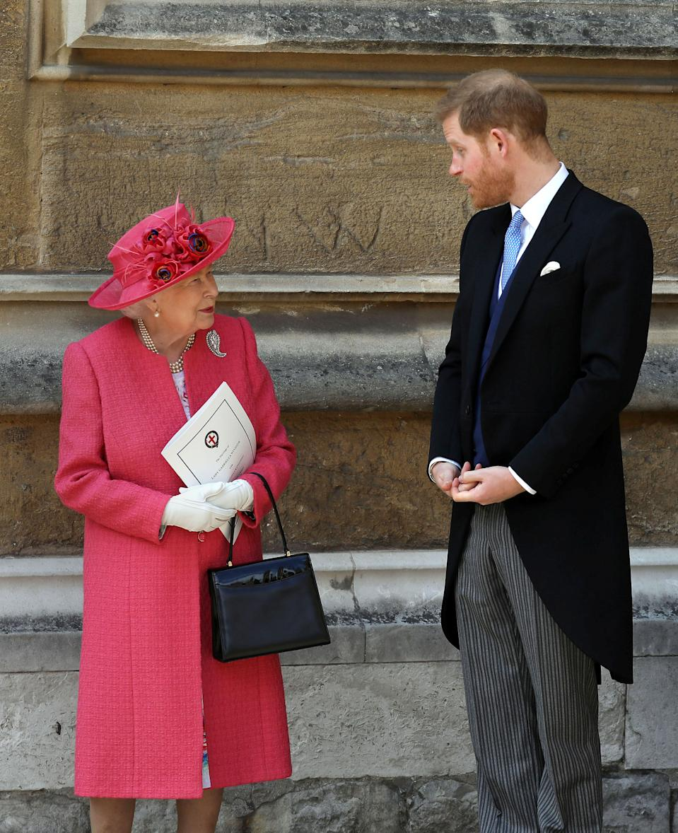 Queen Elizabeth II talks to Prince Harry as they leave after the wedding of Lady Gabriella Windsor and Thomas Kingston at St George's Chapel in Windsor Castle, near London, Britain May 18, 2019. Steve Parsons/Pool via REUTERS
