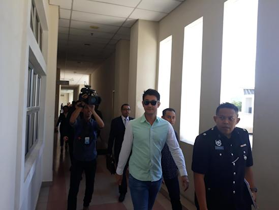 Actor and Director Datuk Farid Kamil (centre) at the Magistrate's Court in Petaling Jaya March 9, 2018. — Picture by Danial Dzulkifly