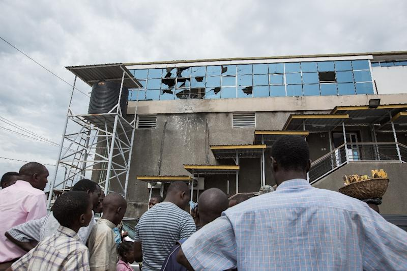 Local residents look at the OcalKing Star Cyber Bar in the Bwiza district of Burundi's capital Bujumbura after a grenade attack in November 2015