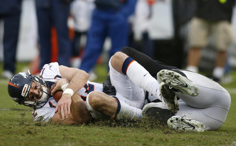 Denver Broncos quarterback Paxton Lynch, left, is sacked by the Raiders. (AP)