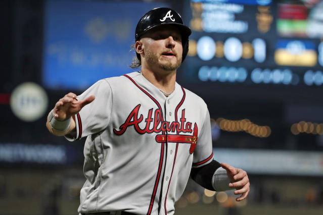 Atlanta Braves' Josh Donaldson scores on a single by Austin Riley off Pittsburgh Pirates starting pitcher Joe Musgrove during the second inning of a baseball game in Pittsburgh, Wednesday, June 5, 2019. (AP Photo/Gene J. Puskar)