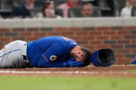 New York Mets' Kevin Pillar lies on the ground after being hit in the face with a pitch from Atlanta Braves pitcher Jacob Webb in the seventh inning of a baseball game Monday, May 17, 2021, in Atlanta. (AP Photo/John Bazemore)